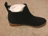 Black ankle boots. Brand new! Never worn! Size 4. Rocket Dog. Missed the return date.