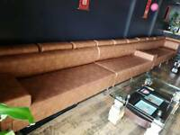 Very long orange real leather sofa