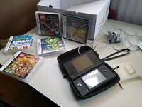 Black ds dsi console with case. charger and 6 games