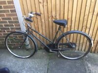 Vintage Raleigh bicycle - roadworthy with new tyres, requires cleaning. Comes with light and basket.