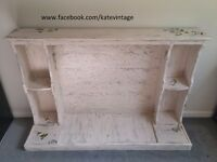 hand decorated wooden distressed look fireplace cover with some decoupage effects