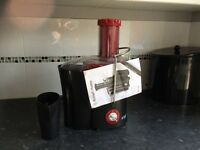 Russell Hobbs Juicer only used twice excellent condition comes with four juice bottles.