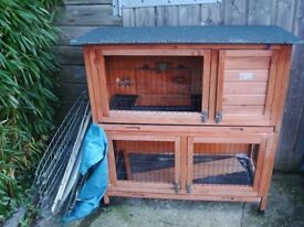 Two storey rabbit/guinea pig hutch needing minor repairs and an outdoor pen