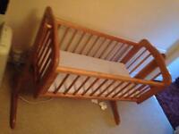 Wooden swinging crib and mattress