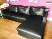 Dwell black leather look corner sofa bed with extra storage