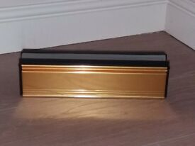Stormguard sleeved letter box draught excluder. Gold/brass coloured