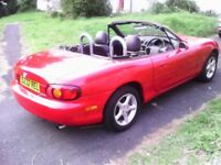Mazda mx5 , stunning through out, with the hard top .
