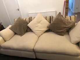 Half leather half material cream 3 seater sofa ex condition selling due to change of colour