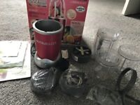 Nutribullet in red with accessories in box