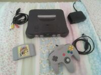 Nintendo 64 console. In great condition with rare, fully working Paper Mario game, cartridge only.