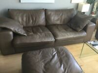 Large comfortable brown leather sofa