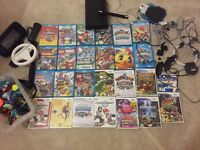 Wii u with 15 games, 40 sky landers , other wii games. Steering wheel , controllers