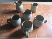 Hand thrown stoneware ceramic mugs, sugar bowl and milk jug