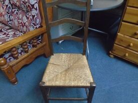 vintage curved ladder back chair with rush seat.