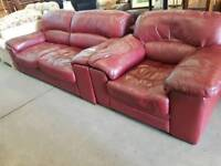 Large red leather two seater sofa and chair set