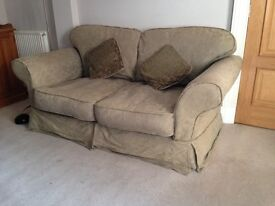 Two seater pale green sofa