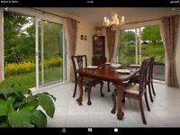 Antique dining table and 6 chairs. Offers invited.