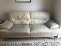 Leather sofa cream with rips as in pics structurally strong