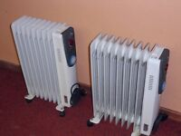 Oil filled electric radiators (2) - 2 kw each.