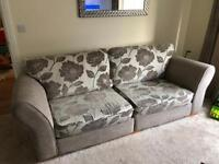 Four seater sofa and a snuggle swivel chair