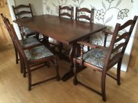 CHUNKY OAK DINING TABLE AND SIX CHAIRS