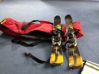 Snow blades and padded bag in good condition