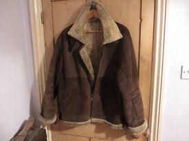 Unisex genuine 100% leather jacket. Super warm and stylish. Approx size 14