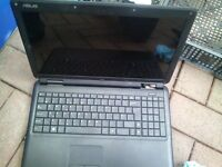selection of laptops, chargers, etc