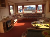 Cheap static caravan sited in essex near beach dog friendly-FREE CREDIT CHECKS-Decking included