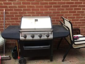 Barbecue in good condition . No longer used or needed .