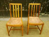 Two Solid Wood Dining Chairs