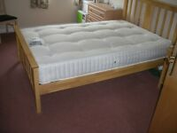 Medium sized bed and mattress barely used.
