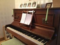 Antique piano and stool. Beautiful wood. Lovely sound. Great for beginner or more advanced.