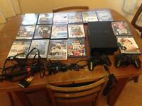 PlayStation 2 with 16 Games, 2 Controllers and 2 Microphones