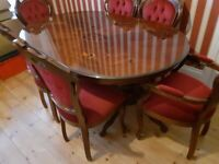 Table and 6 chairs 2 of which are carvers. Excellent condition.