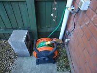 garden hose with nosle and frame