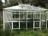 12ft x 8ft Modern Greenhouse in excellent condition with full staging and a lockable door