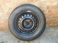 CAR WHEEL WITH A NEW TYRE