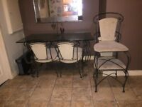 Glass top table and 4 x chairs
