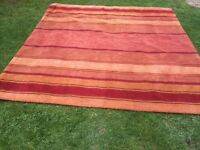 Wool rug for sale 8ft x8ft Red oranges and deep yellow thick good condition