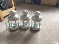 Three white lanterns