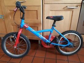 "Kids blue b'Twin bike with red ""supertiger"" pictures and 12"" wheel."