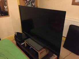 """42"""" Panasonic T.V and stand with control"""