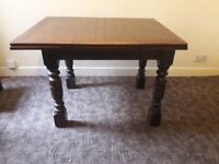 Extendable dining room table and three chairs