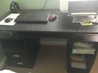 Black computer desk with black chair