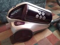 Cylinder bagless hoover, very good condition, burgandy colour, make is also hoover, tools include