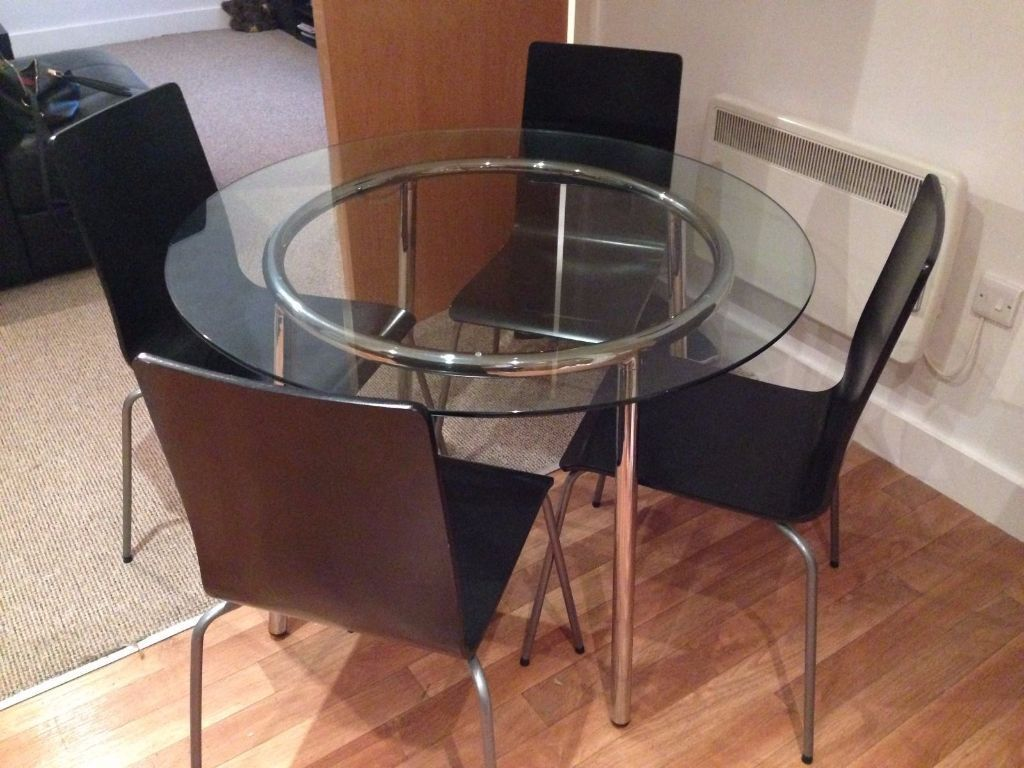 Ikea salmi glass dining table with 4 ikea martin chairs black in halifax west yorkshire - Round glass dining table ikea ...