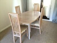 Beautiful dining table with four high back chairs