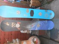 pair of vintage snowboards.burton 53 and gnu stupid cap 150.