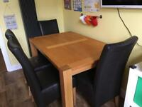Solid oak table and 4 leather chairs